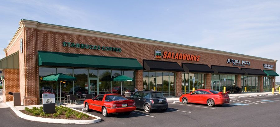 Commercial awnings over multiple businesses in Wilmington, DE plaza