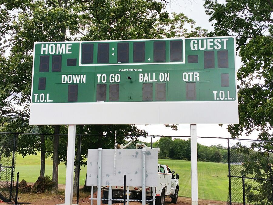 Custom scoreboard and business sign combination